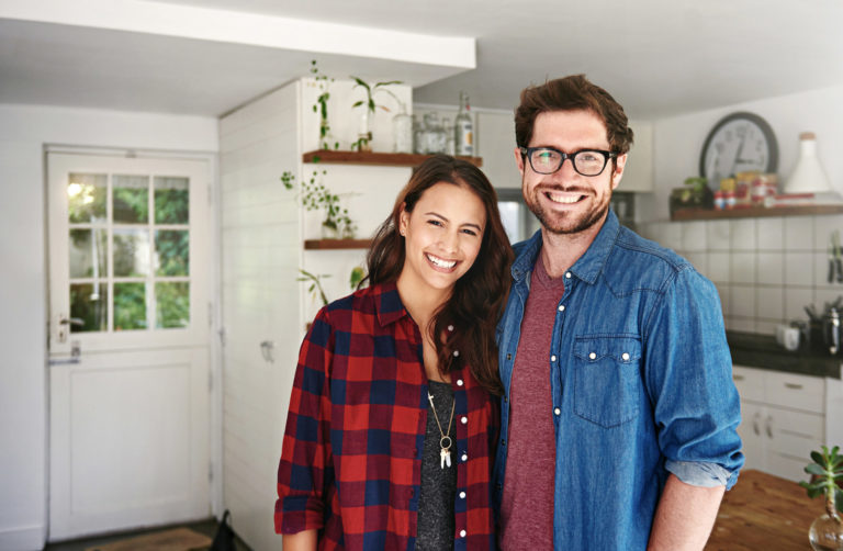 young couple standing in the kitchen for advance directives