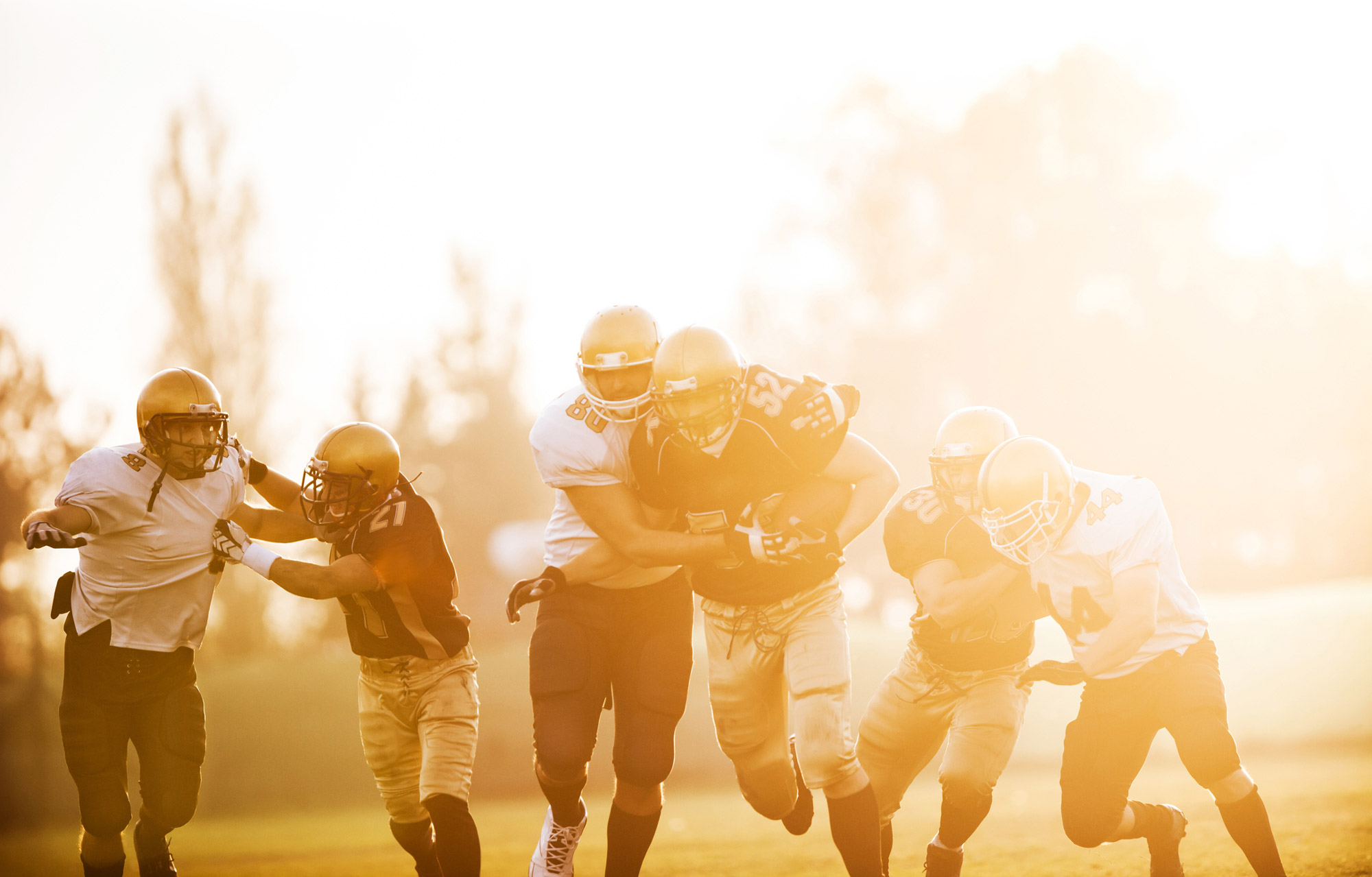 football players running on the field