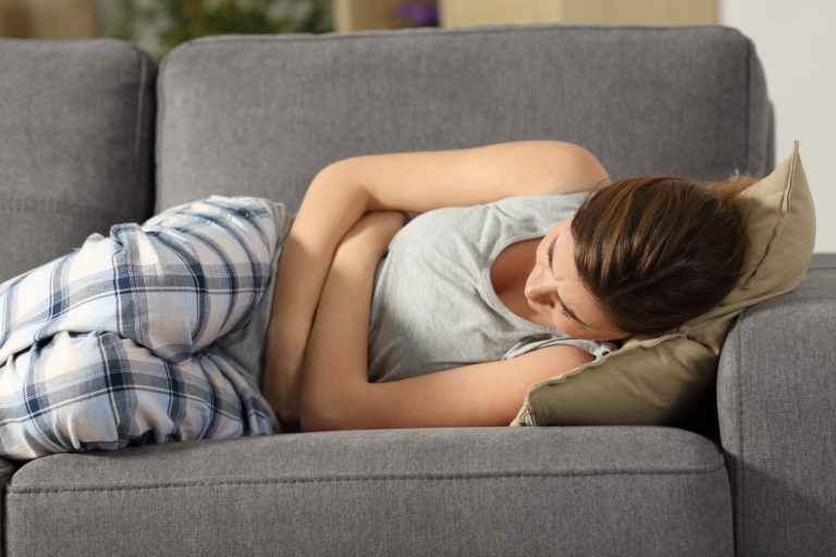 woman on the couch with cramps