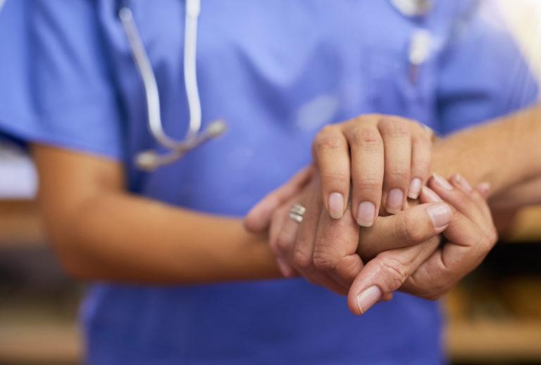 nurse-holding-patient-hands