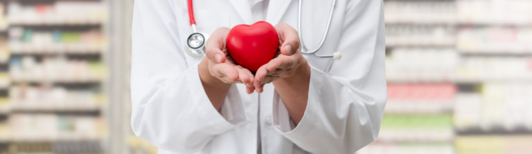 Doctor holding red heart for Cardiology Specialists