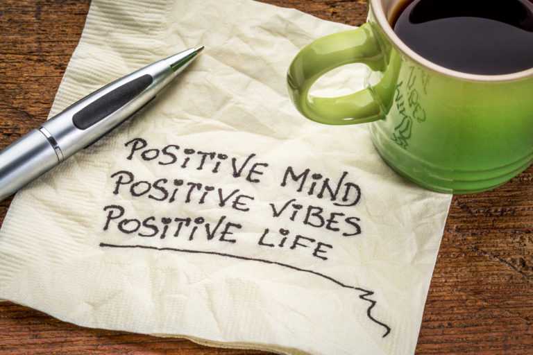 positive mind, vibes and life written on a napkin