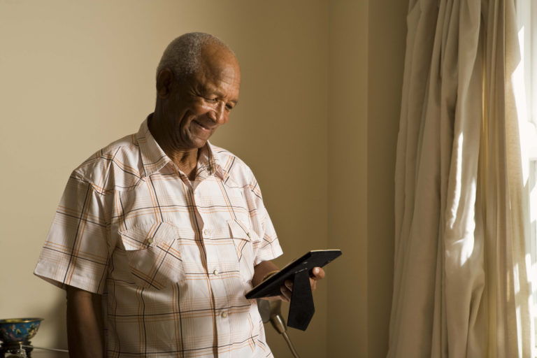 Senior man looking at photograph