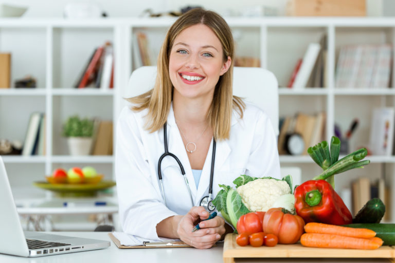 Registered Dietitian with vegetables