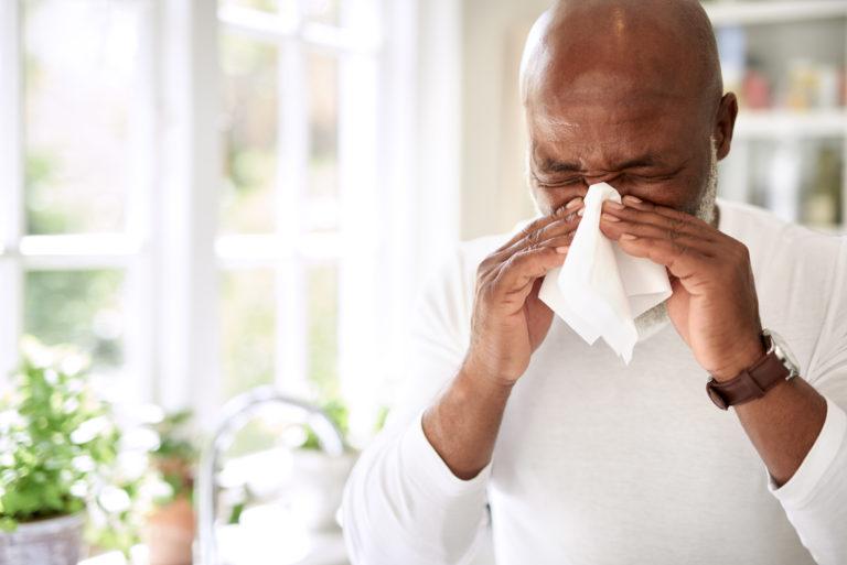 Man reacting to allergies