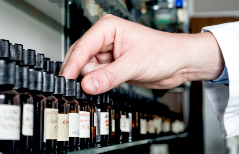 Perfumes Industry. Chemical in Laboratory Choosing Bottles.