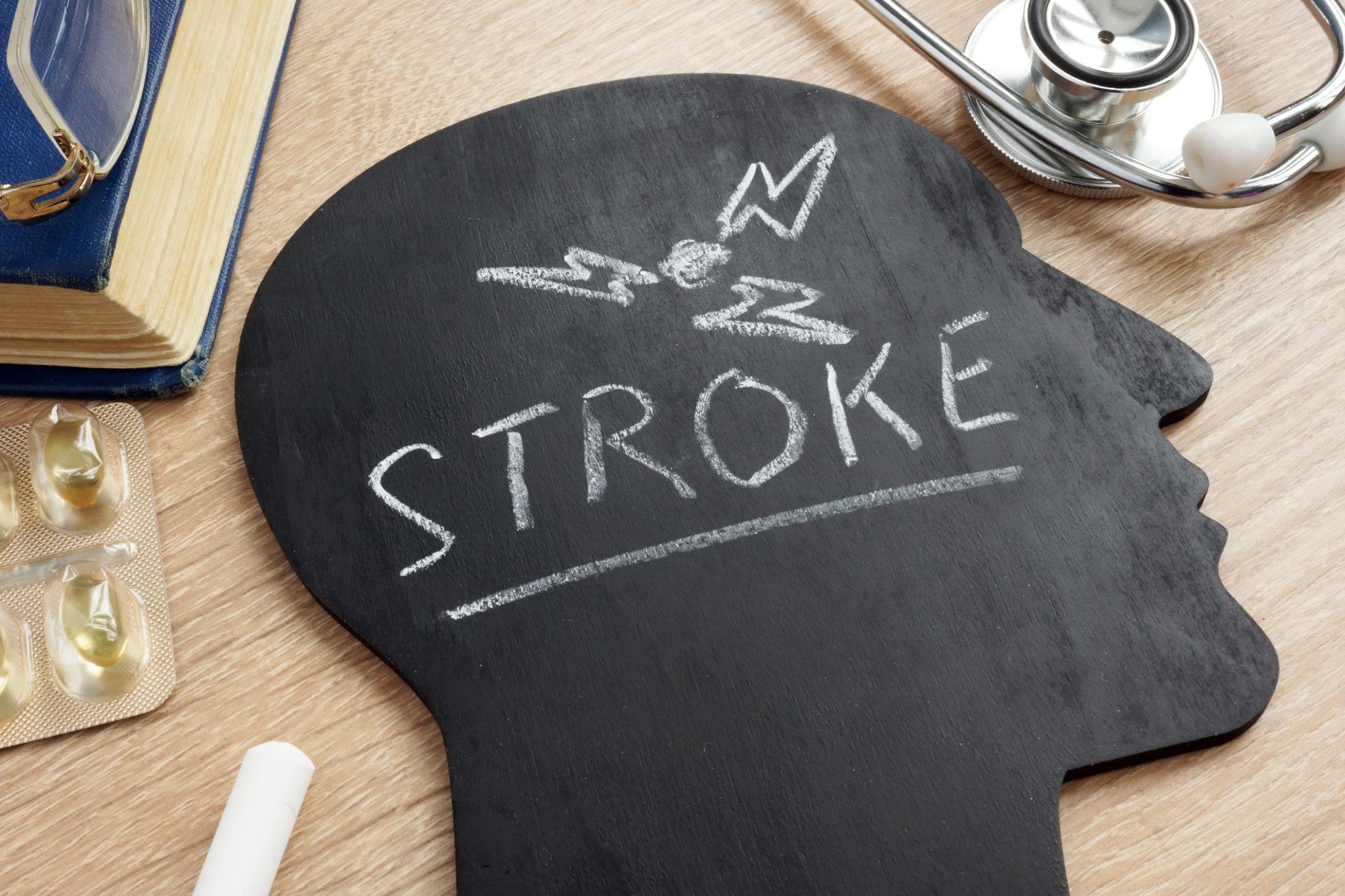 Disease Stroke written on a head shape chalkboard