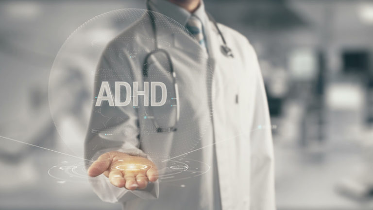 Doctor holding in hand ADHD