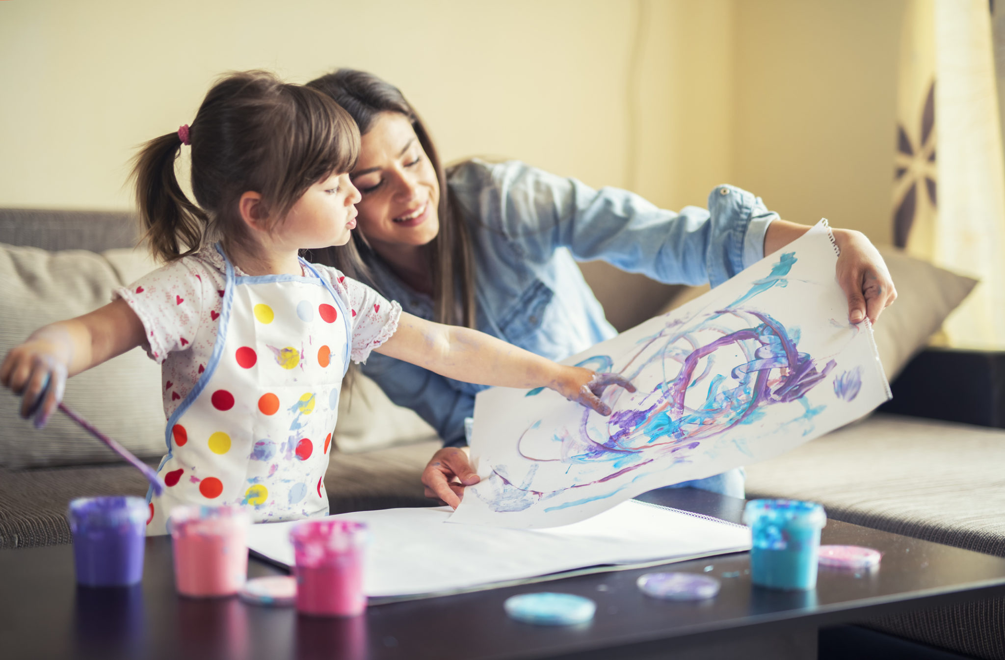girl painting with mom