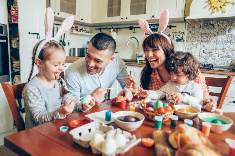 family dying Easter eggs