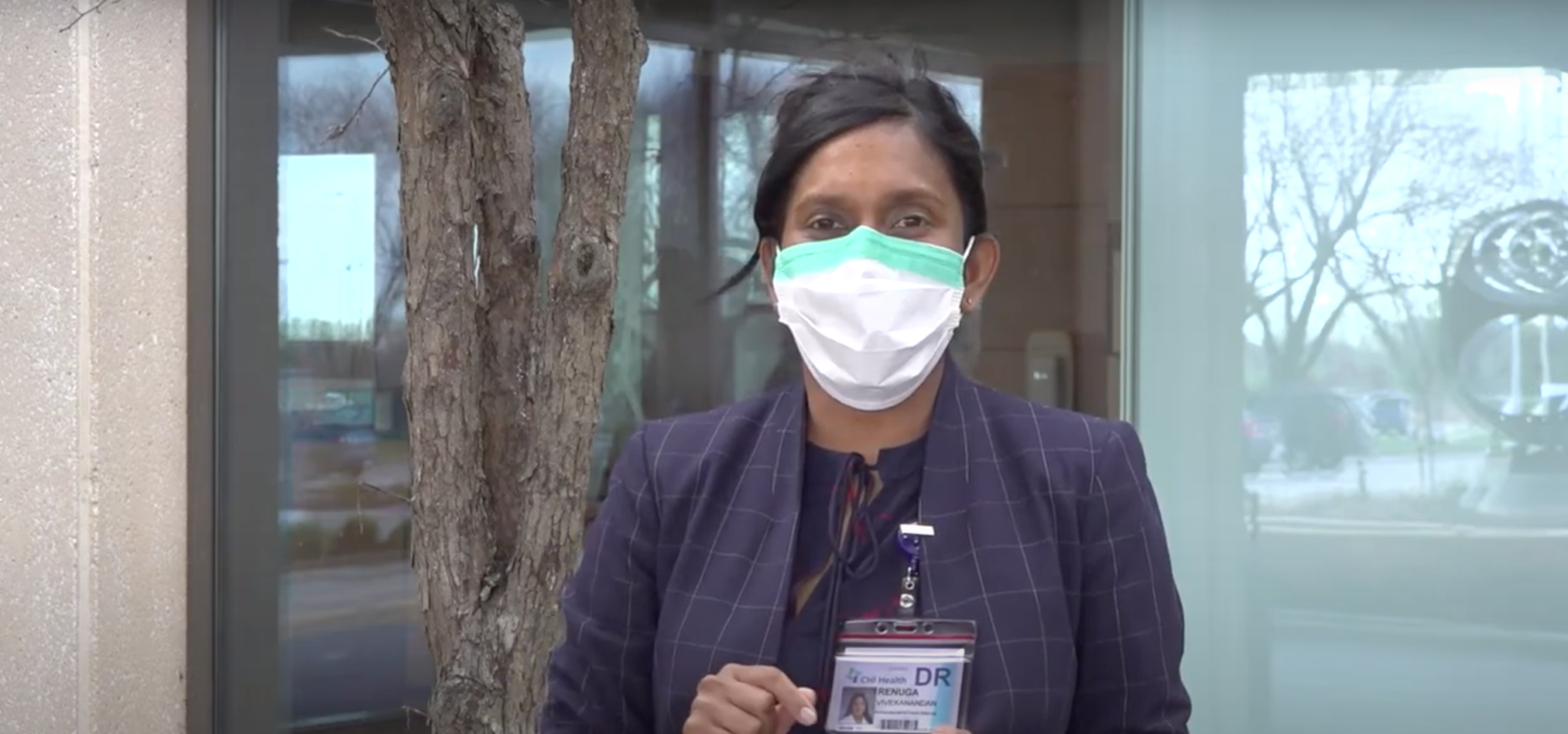 Dr. V demonstrating how to properly wear a mask