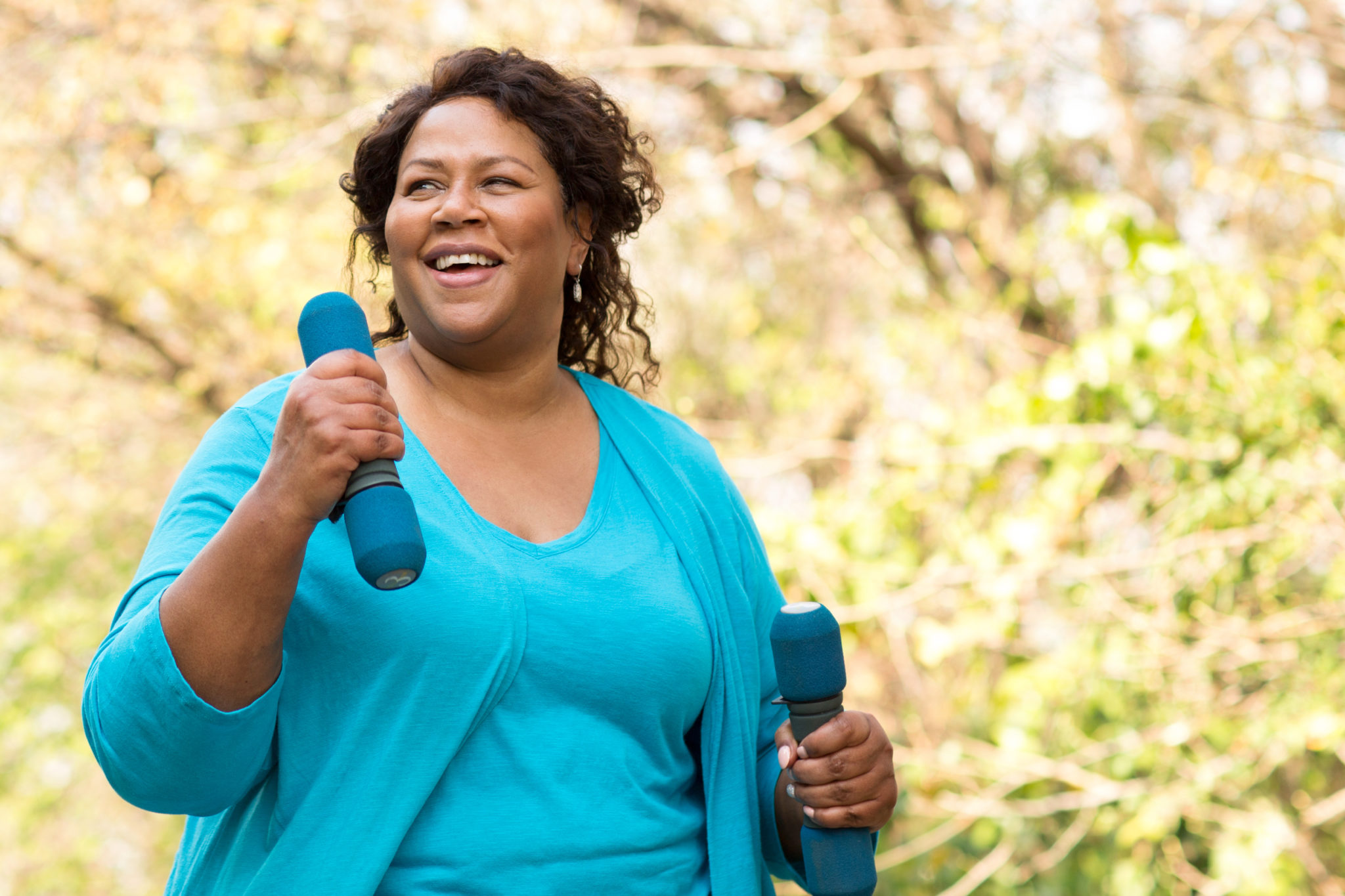 Mature African American woman smiling and exercising.