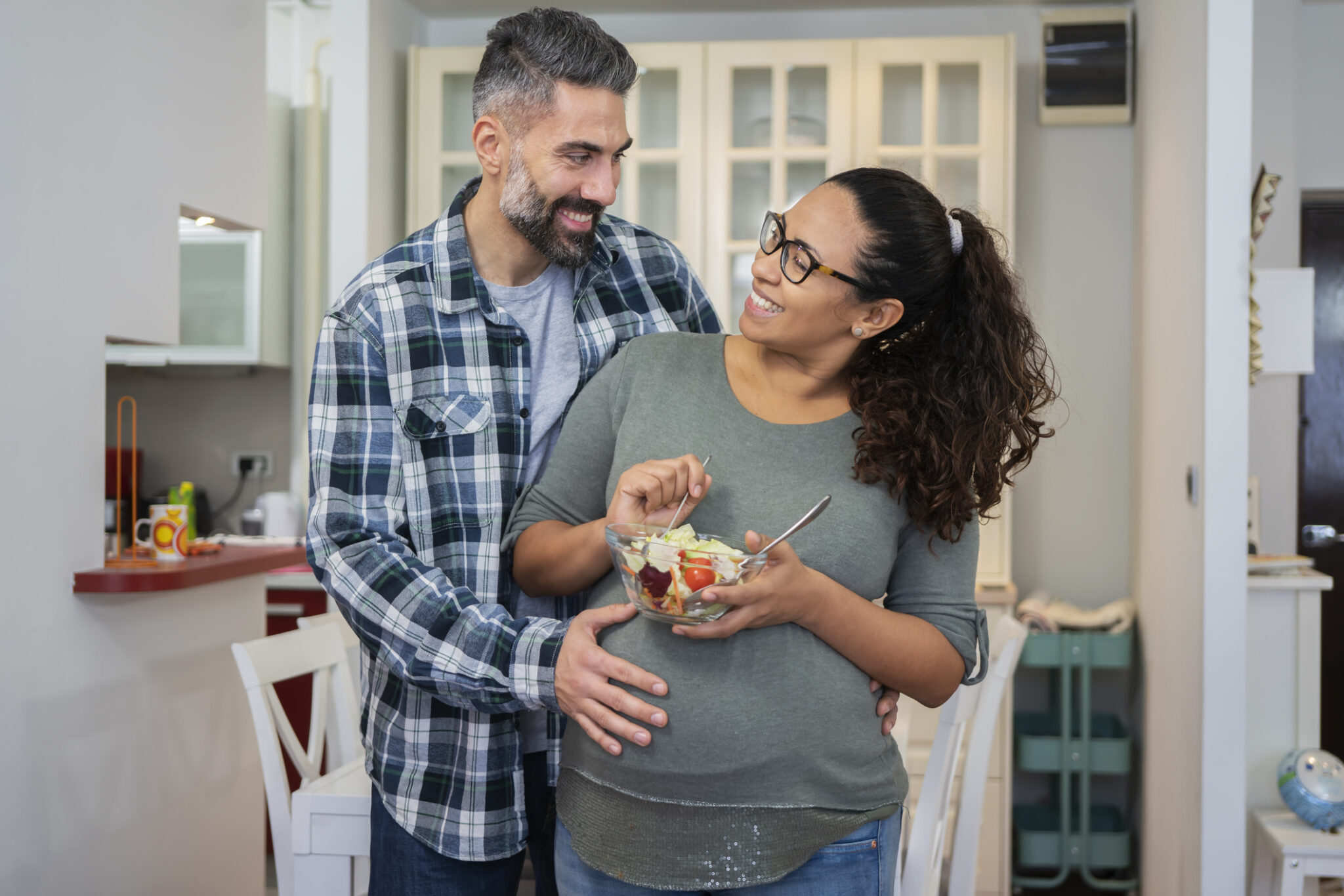 Mature multiethnic couple in kitchen
