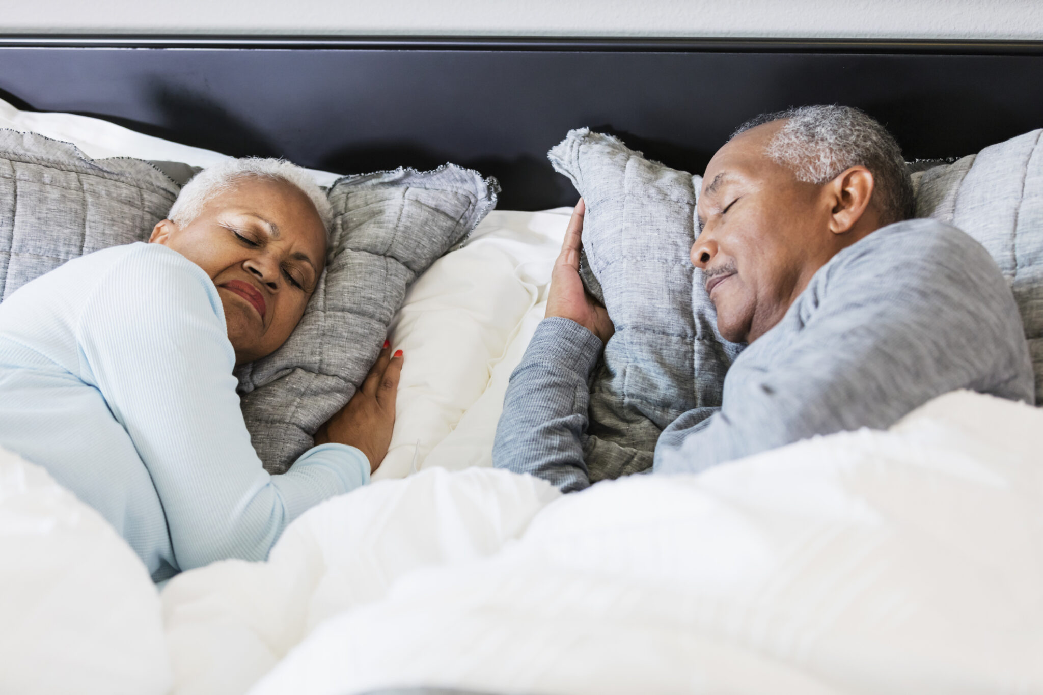 Senior African-American couple sleeping