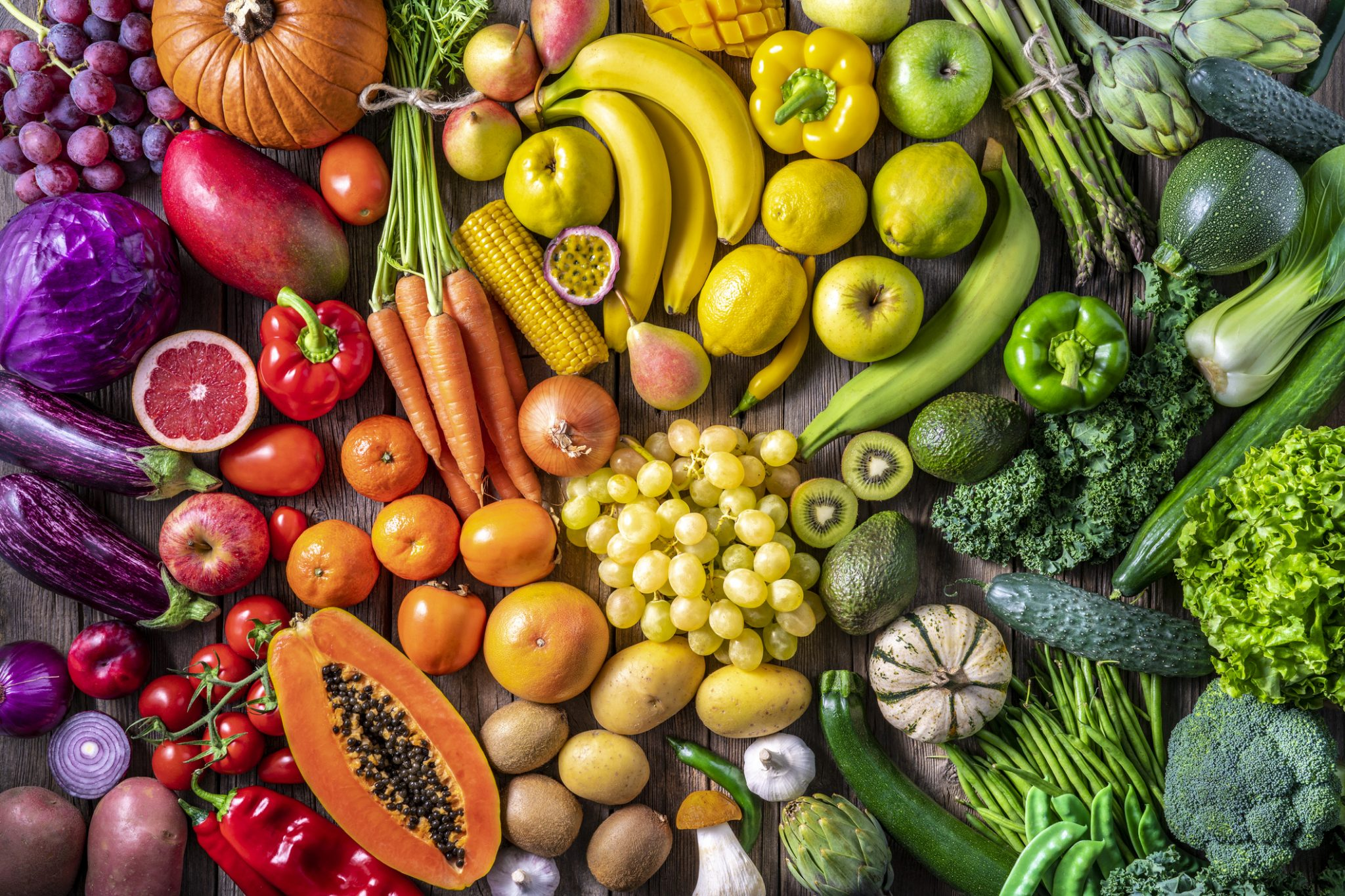 Colorful vegetables and fruits vegan food in rainbow colors