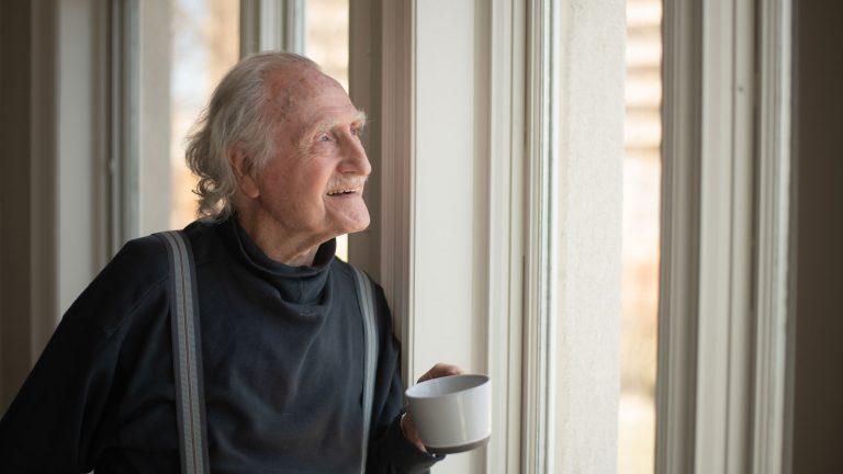 older gentleman looking out the window